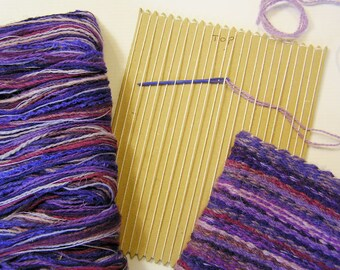 Card loom weaving kit to make a purple woven bag