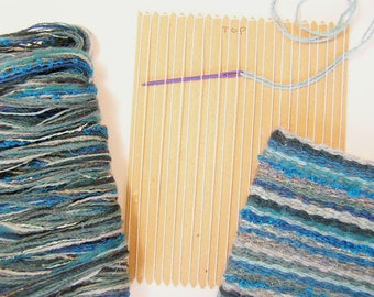 Card weaving loom to make a teal coloured woven bag