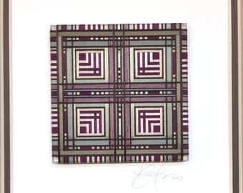 Framed Thread Wrapping with Burgundy and Sage Green Owl Feather Design in a Brown Frame with Double Matte