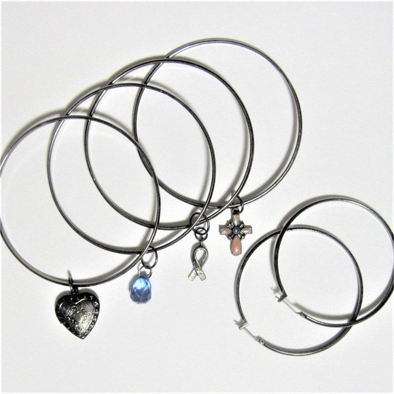 Four Vintage Bangles with Charms plus Matching Hoop Earrings Gunmetal Heart Locket Blue faceted Drop Hope Ribbon Enamel Cross