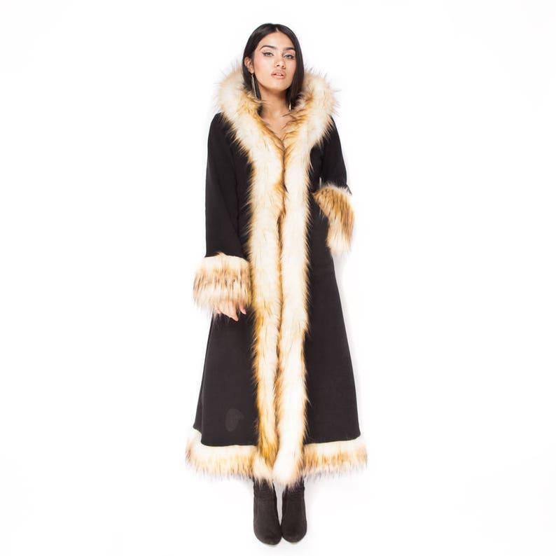 70s Jackets, Furs, Vests, Ponchos     Read the full title    Baroness Creambrule & Black Faux Fur Coat Festival Coat Festival Clothing $240.00 AT vintagedancer.com
