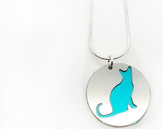 Double sided Cat pendant of stainless steel and recycled aluminum