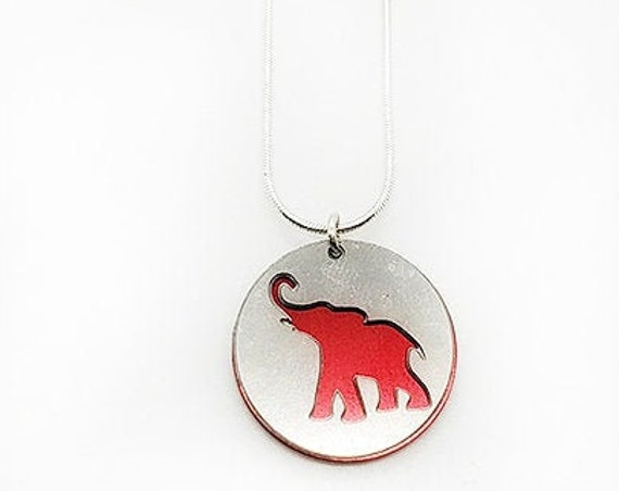 Double sided Elephant pendant of stainless steel and recycled aluminum