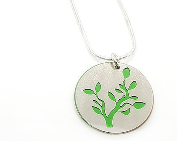 Double sided Branch pendant of stainless steel and recycled aluminum