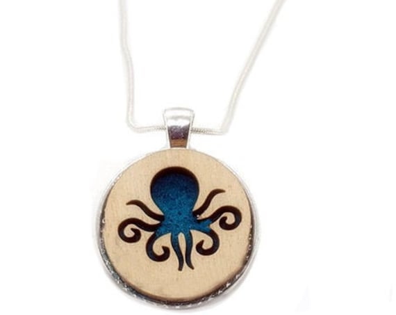 Octopus pendant of plywood and felt