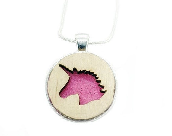 Unicorn pendant of plywood and felt