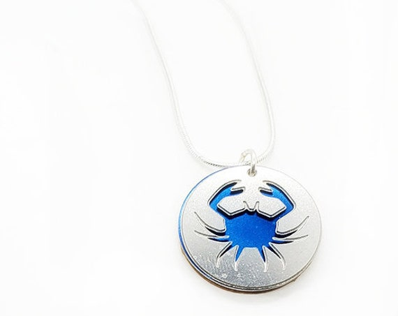 Double sided  Crab pendant of stainless steel and recycled aluminum