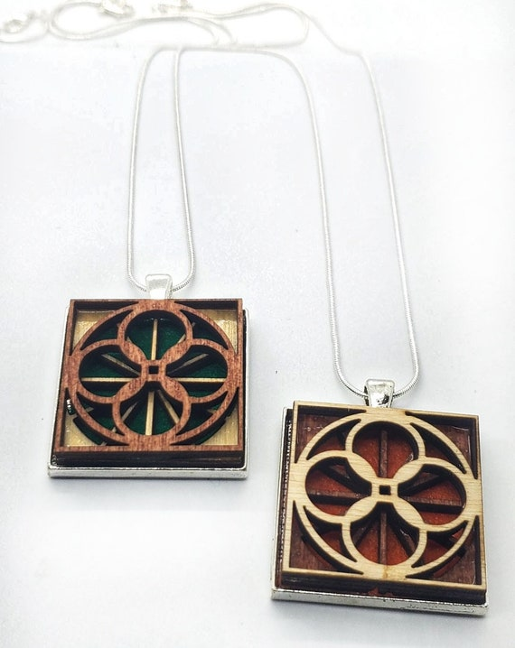 Abstract 2 pendant of plywood,redwood and felt set into stainless steel