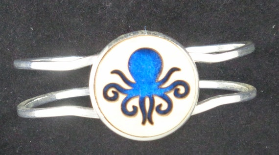 Octopus Cuff Bracelet from cut Plywood and Felt set into Hinged Stainless Steel setting