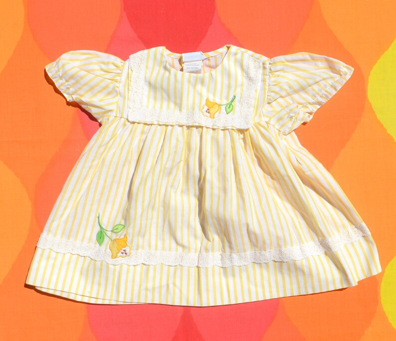 3e0d4be9ca49 Vintage 70s baby girl dress NANNETTE yellow stripe flower