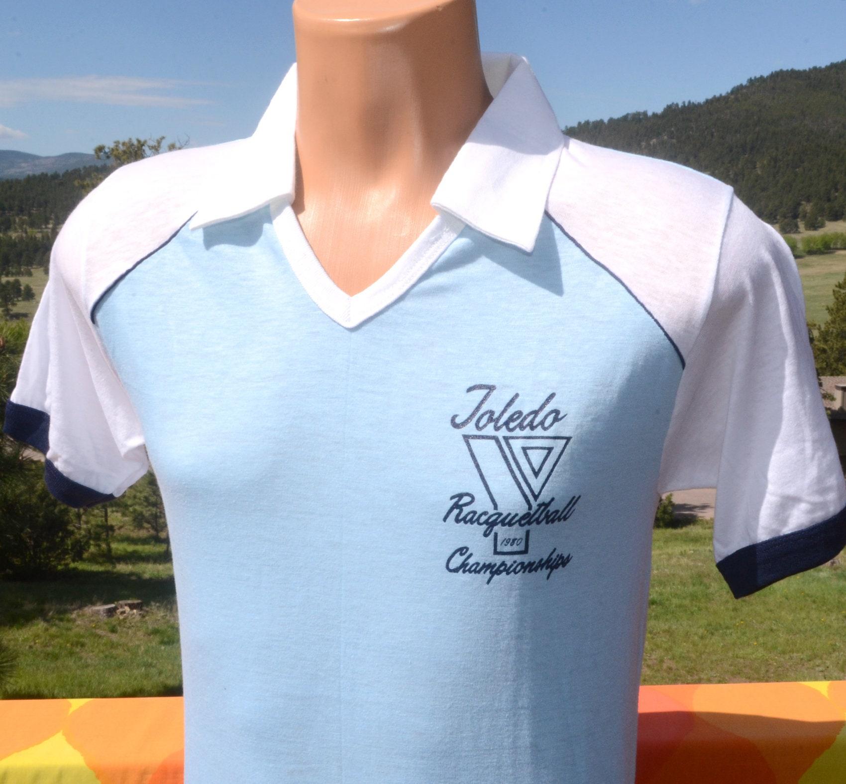 0c4e58109 vintage 80s t-shirt RACQUETBALL toledo 1980 Medium Small champion blue bar