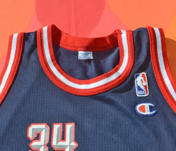 47d2cdd9aeaf Vintage 90s kid basketball jersey houston rockets OLAJUWON nba