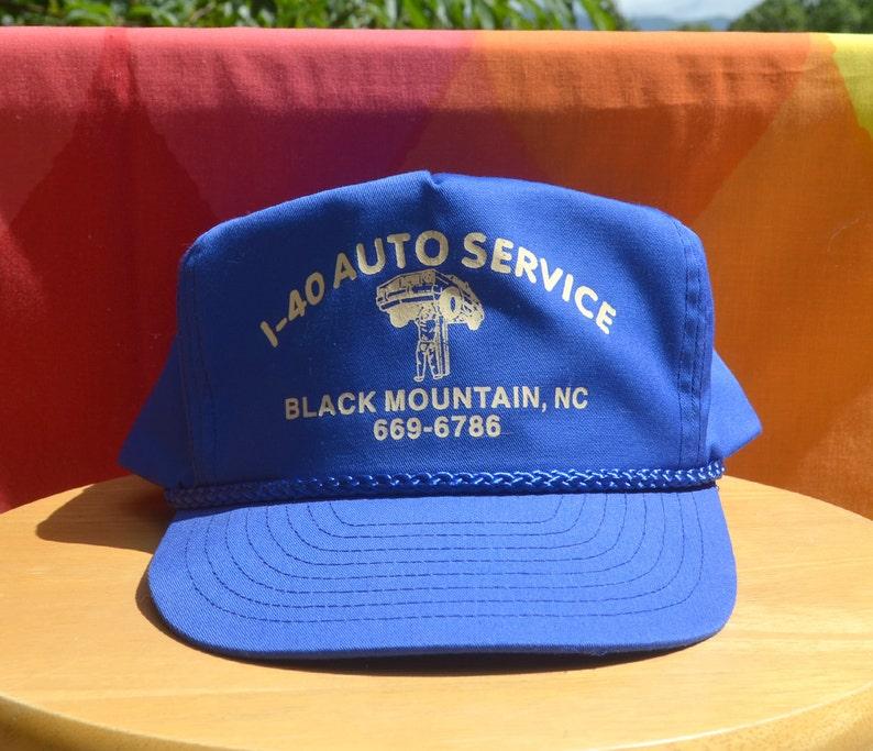500f43490a0d9 80s vintage snapback trucker hat BLACK MOUNTAIN nc blue mesh