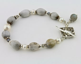Bracelet, African Infabinga Seeds, Freshwater Pearls, Handcrafted Silver Clasp by Carol Ann Bosek