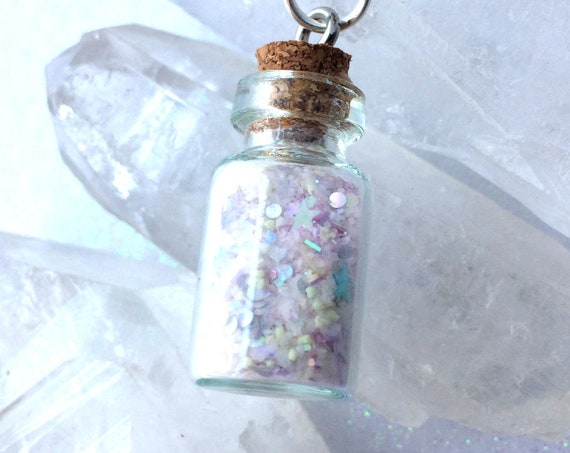 Glowing Dust of a Fairy from a Pixie Garden Glow in the dark Necklace