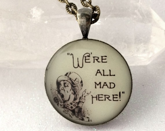 "We're All Mad Here Alice in Wonderland quote glow in the dark Hatter 1"" pendant Through Looking Glass"