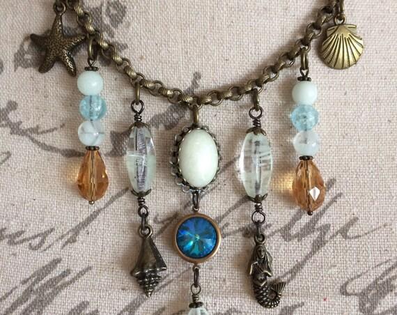 Mermaid Statement Necklace Seashells Glow Necklace Crystal Teardrop Beads Antique Brass Vintage Style Glowing Opal Galaxy Beaded Ocean Glow