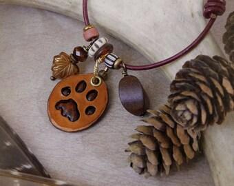 Bobcat - woodland charm bracelet with leather, wood, brass