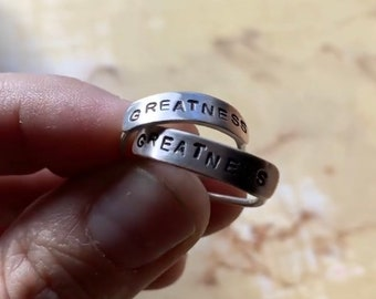 Custom handforged sterling silver stacking poetry rings.