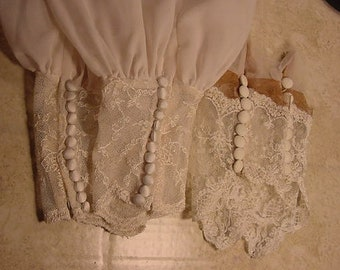 Two pair of lower lace cuttings is from vintage wedding dresses.