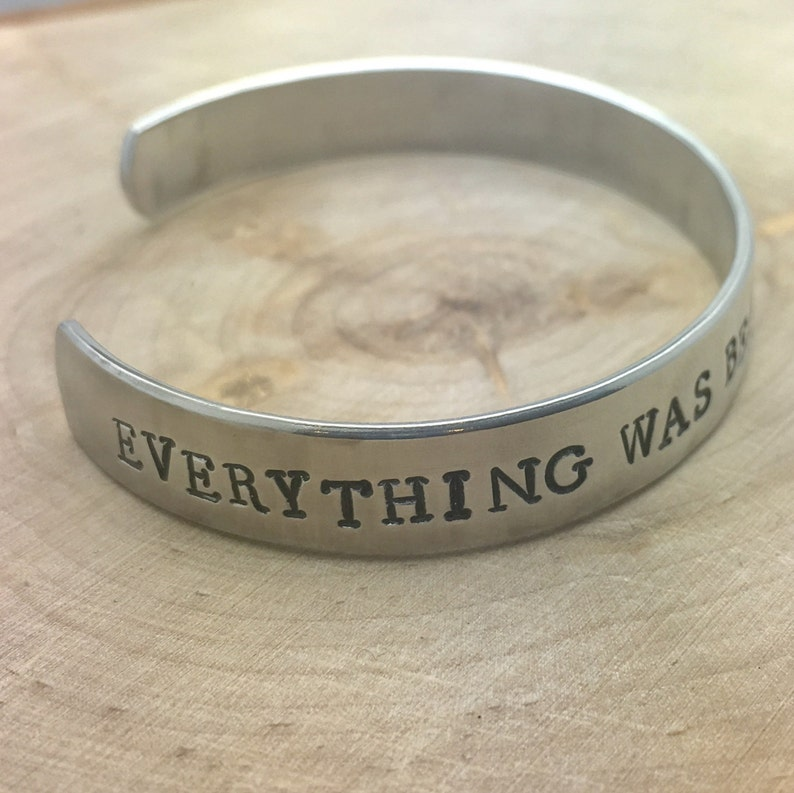 Everything was beautiful and nothing hurt hand stamped cuff image 0