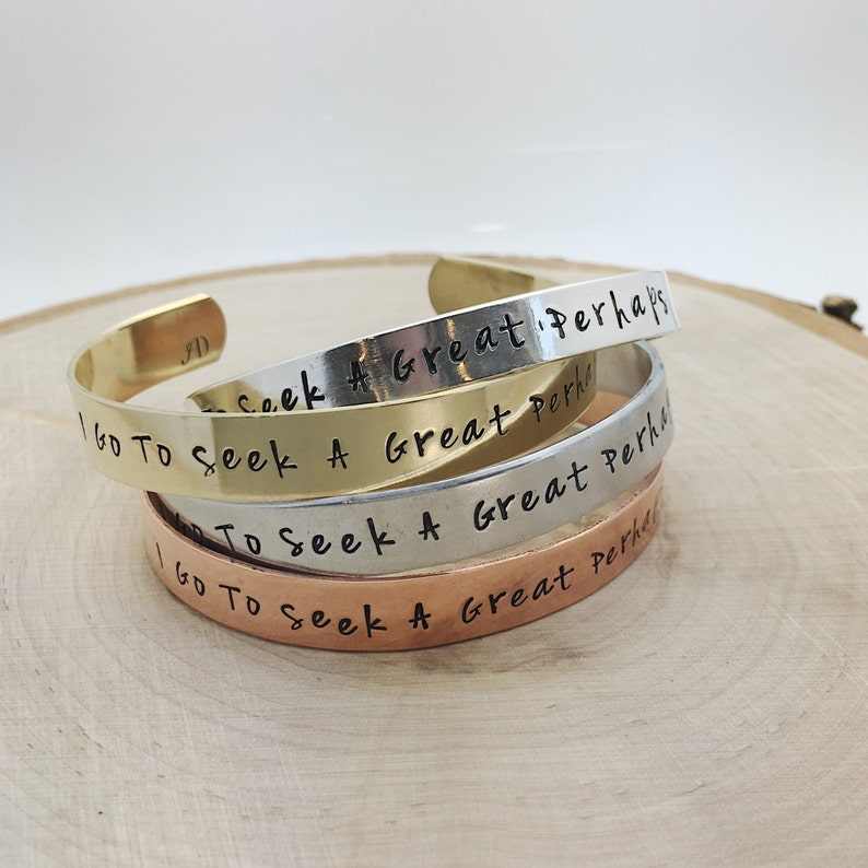 I Go To Seek A Great Perhaps hand stamped cuff bracelet in image 0
