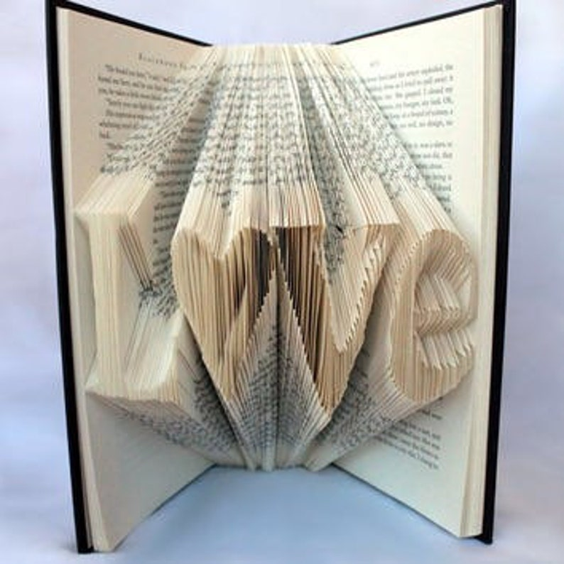 Custom Folded Book Art. Up to 6 characters. You tell me what image 0