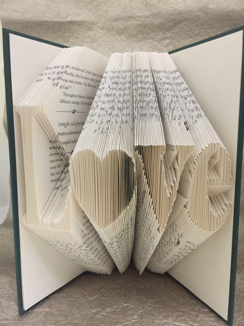 Custom Folded Book Art. Up to 6 characters. You tell me what image 1