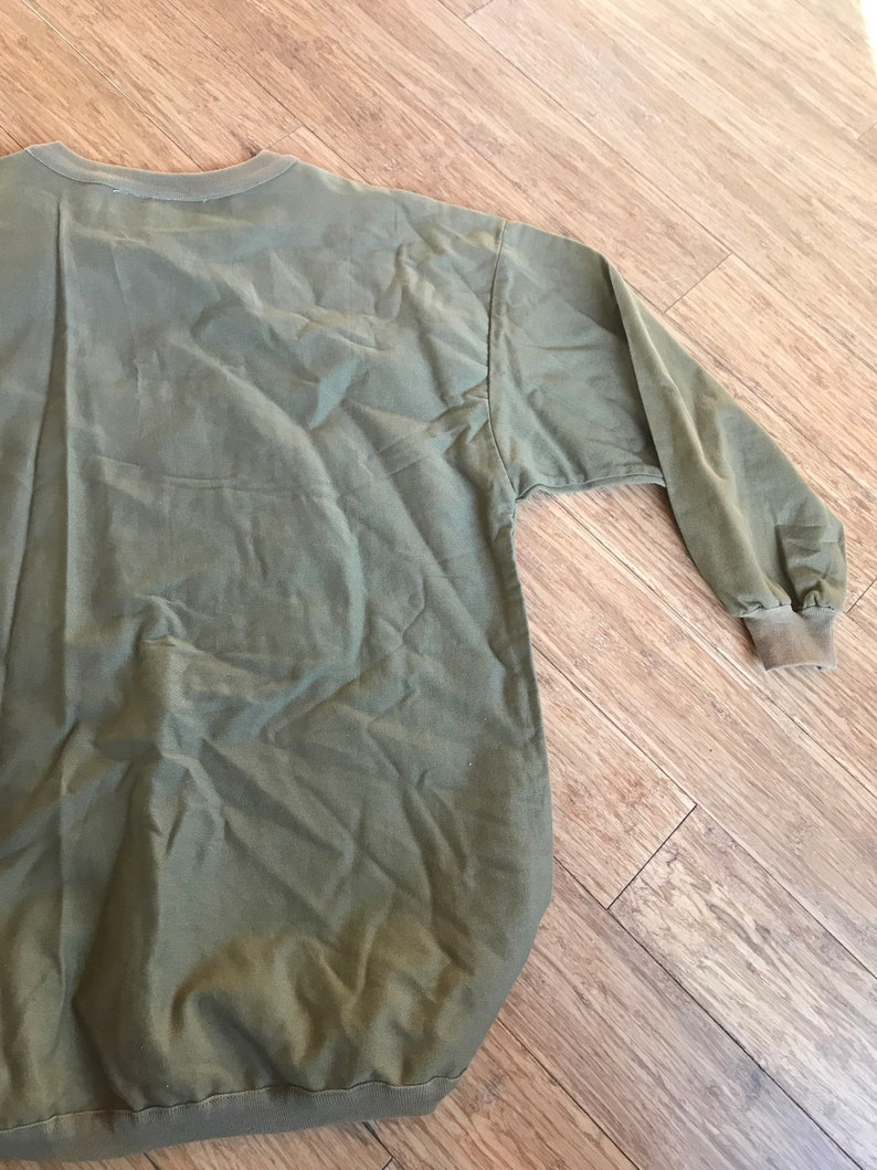 olive green airplane long sleeve top dancing on the ceiling olive green top size small