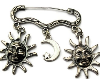 Sun and moon silver tone brooch/pin