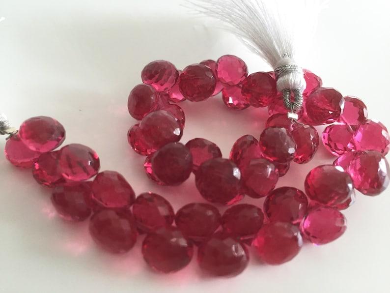 Pomegranate colored hydro quartz faceted onion