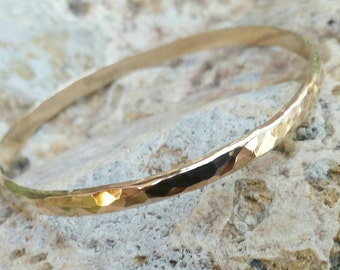 Gold Bangle Bracelet thick, wide with hammered shiny texture. Available in Gold Filled, Rose Gold Filled, 14kt Gold, or 14kt Rose Gold.