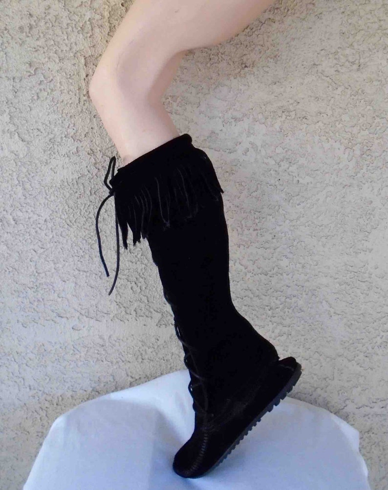 9ba7a6b2bf424 Vintage Early Nineties Tall Black Suede Fringed Lace Up Flat Sole Native  Indian Style Boots by Minnetonka / Size 7