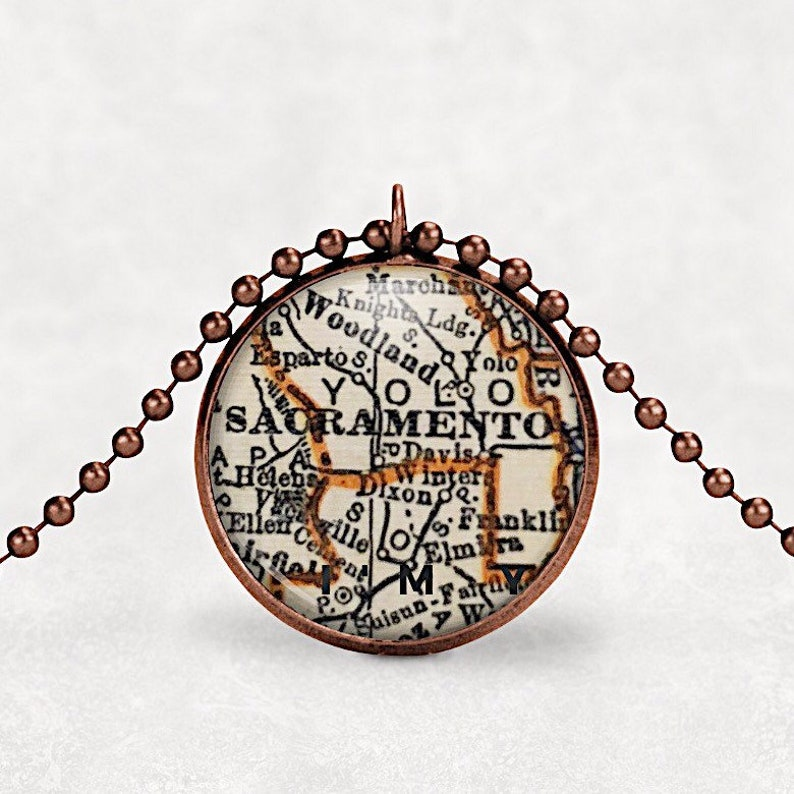 Map pendant necklace Sacramento CA travel jewelry moving image 0