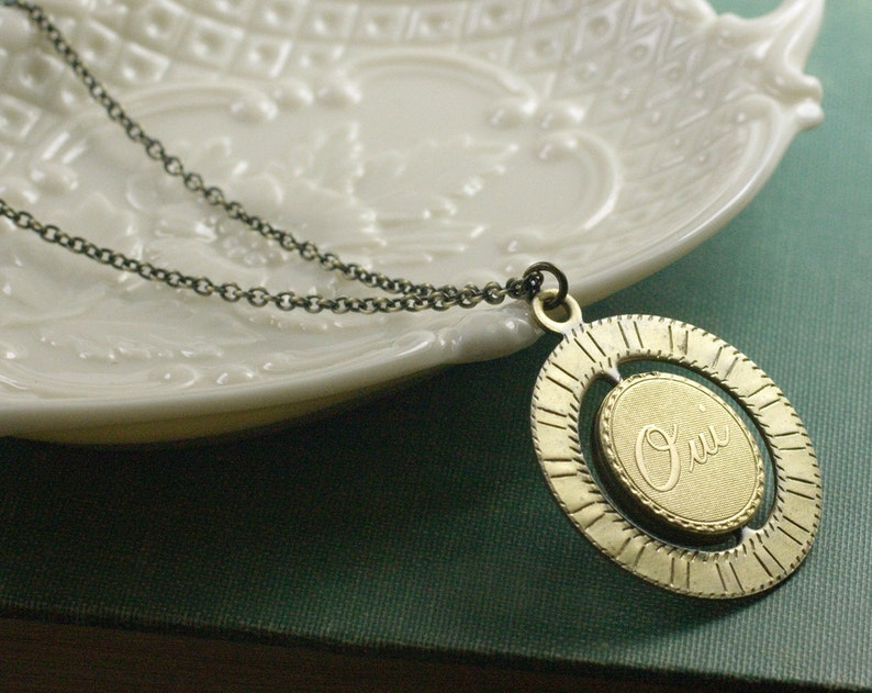 Oui necklace French spinner vintage brass yes no mood retro image 0
