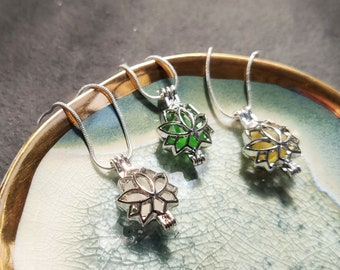 Mediterranean Sea treasure silver lotus locket necklace with sea shell hag stone or sea glass on a minimal snake chain
