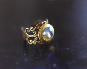 Crescent moon locket ring on antique bronze filigree band - the Moonlight Traveller
