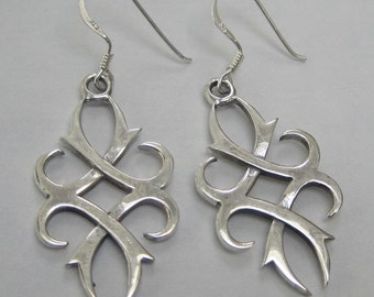 Sterling silver curled criss cross earrings- free shipping