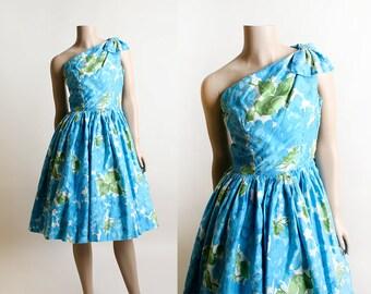 Vintage 1950s Dress - One Shoulder Aqua Blue Floral Watercolor Dress -  Olive Green - Cotton Sundress - Bow Shoulder - XS 90ca73fef