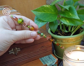 copper candle snuffer wickwand Christmas ornament magick wand one of a kind handmade with green and amber glass beads