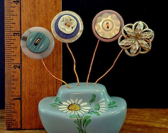 unique handmade vintage buttons and baubles flower bouquet knick knack curio in antique blue ceramic salt shaker painted in daisies