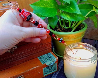 copper candle snuffer magickal wand Christmas ornament handmade with red and black glass beads original design one of a kind