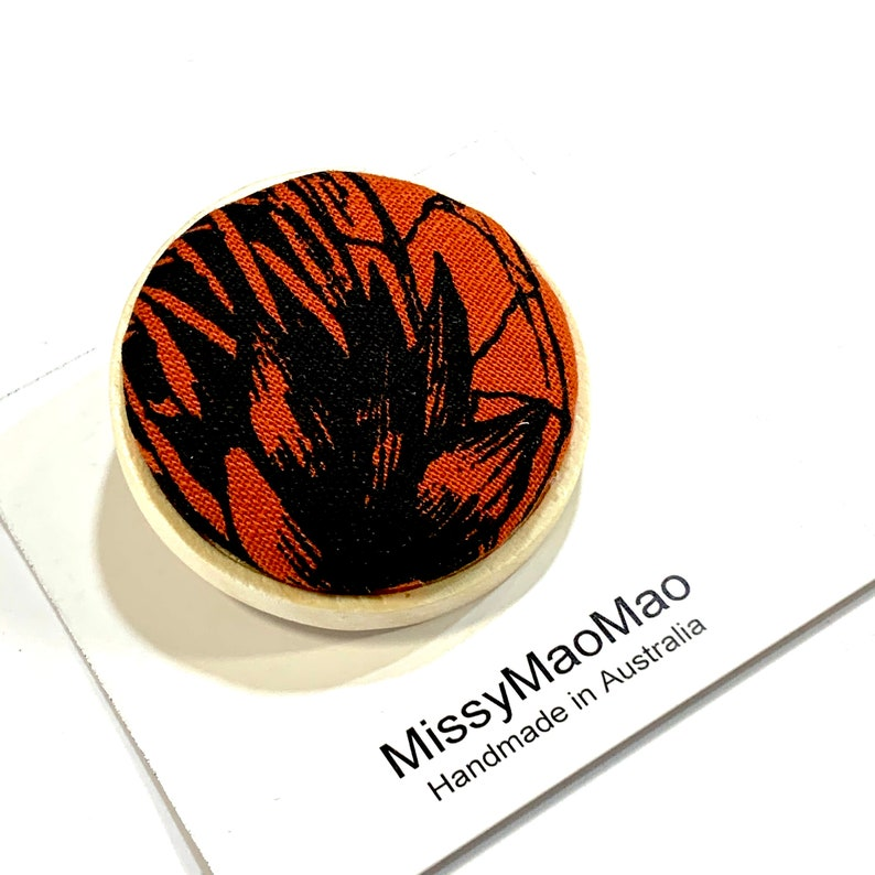 Fabric brooch large with wooden base featuring handprinted fabric.