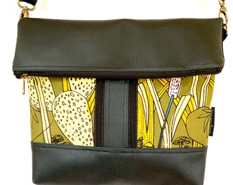 Cross body zipper vegan bag with jungle print fabric pockets on the front