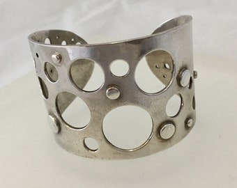 Chunky Sterling Silver cuff bracelet with cut out circles and rivets