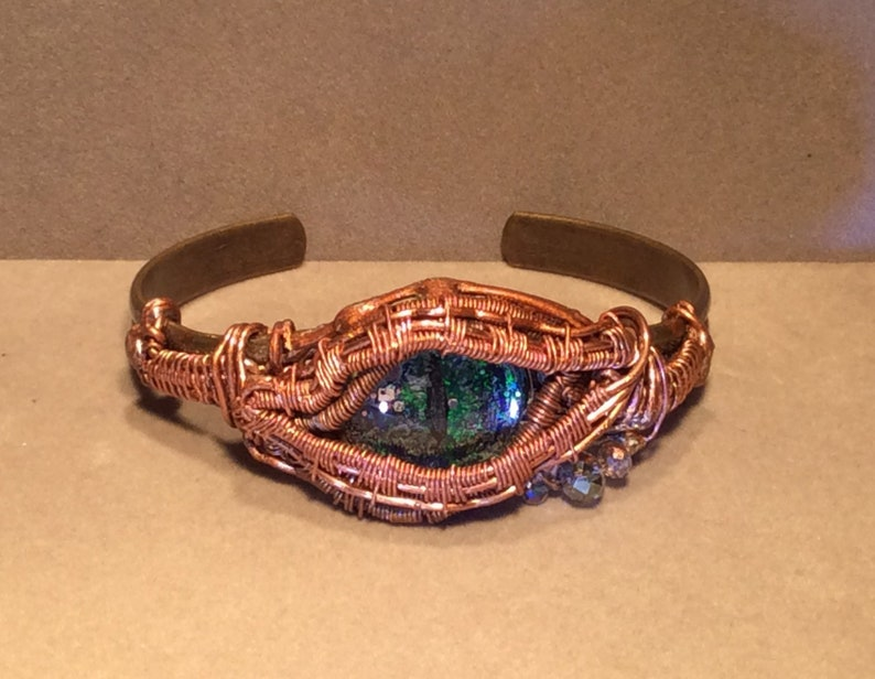 Bracelet, Dragon Eye, wire wrapped with copper on a brass base with grey  crystals