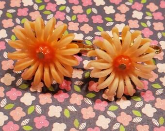 Clip earrings, sunny orange plastic flowers, small