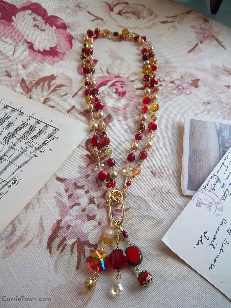 Versatile crimson and gold beaded necklace made with crystals image 0