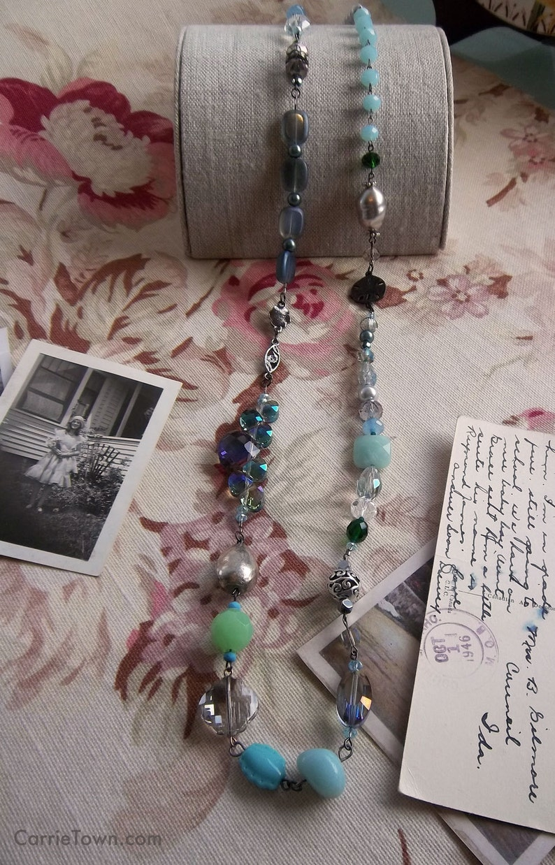 Beaded crystal and freshwater pearl necklace featuring the image 0