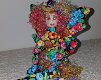 Whimsical, fiber sculpted flower fairy, silk face, Swarovski crystal accents